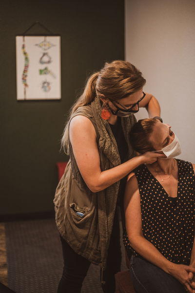 Dr. Brynn adjusts a patient's neck in Wurth Chiropractic's office.